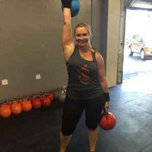 Woman with kettle bells