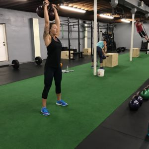 woman working out with kettle bells