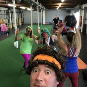 People in halloween costumes working out