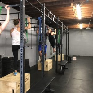 Women doing group pull ups